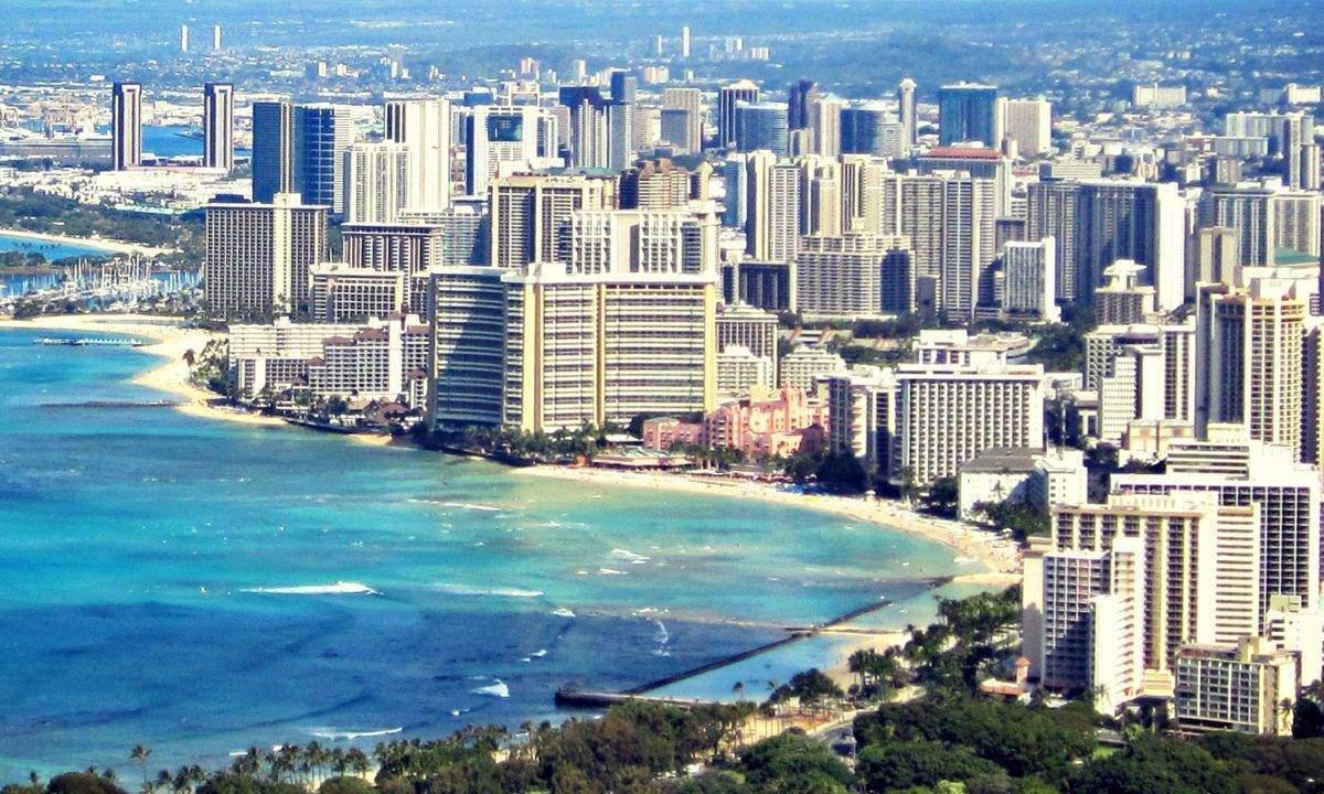 The Royal Hawaiian today, dwarfed by the Waikiki skyline.
