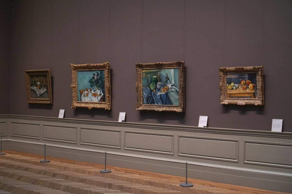 A row of still life paintings by Cezanne