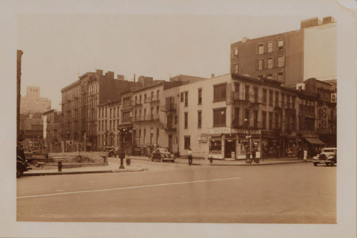 The south side of East 11th Street from 4th Avenue in 1936, image courtesy the New York Public Library.